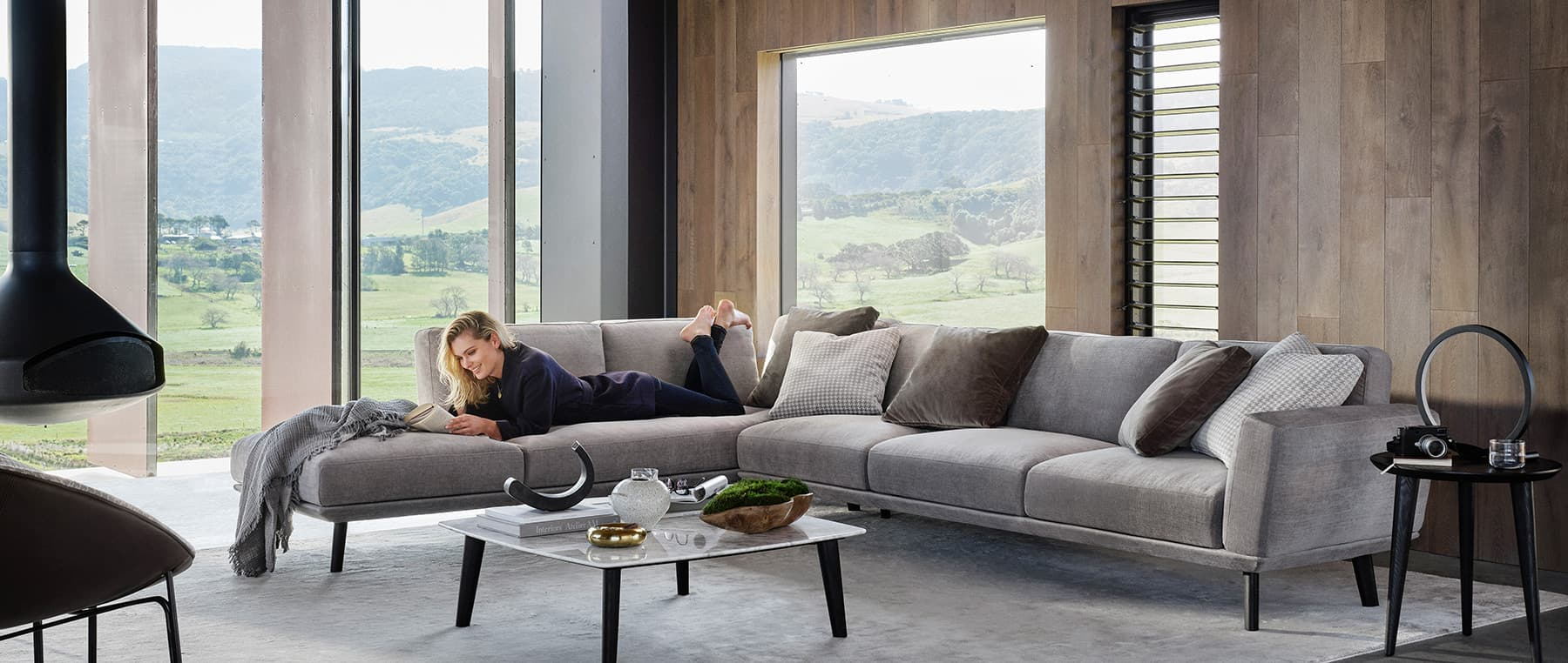 squarerooms king living sofa grey living room woman reading