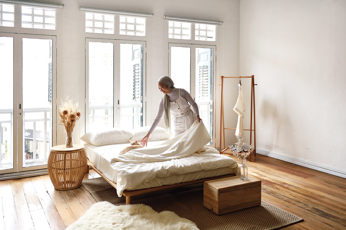 squarerooms sunday bedding woman folding sheets bedroom sunny cosy vibes