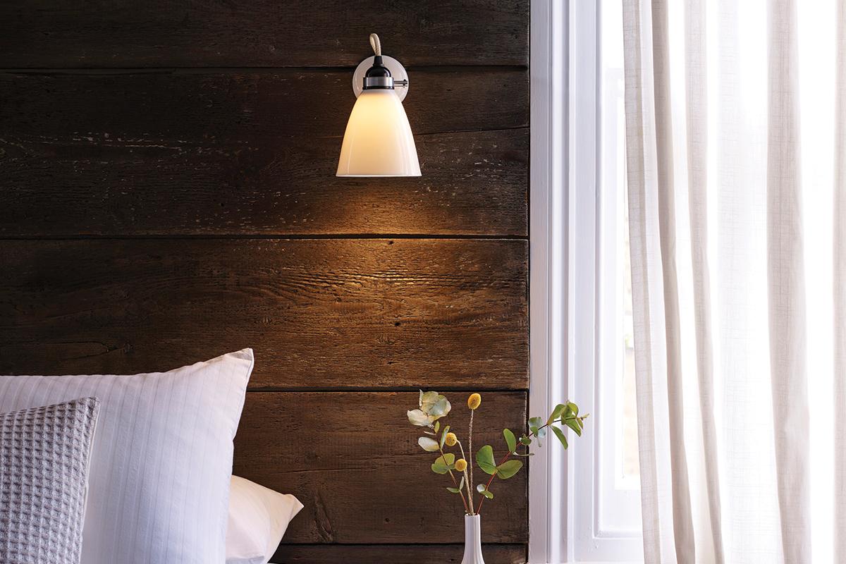 squarerooms original btc white bedding wall lamp warm yellow light