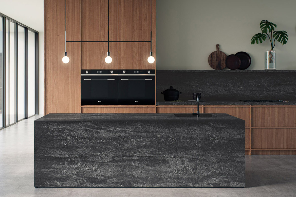 squarerooms caesarstone kitchen dark collection engineered quartz counter surface black red cabinets warm wood