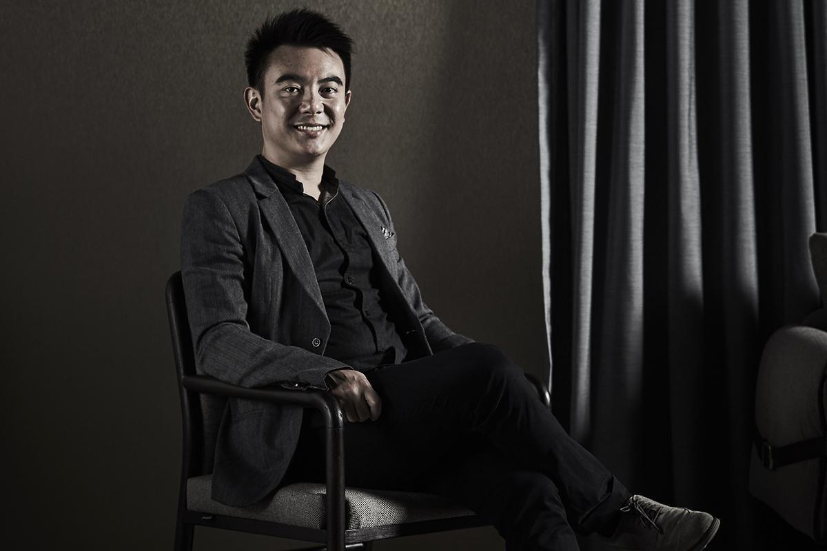 squarerooms Gan Shee Wen commune chief operating officer sitting dark black background