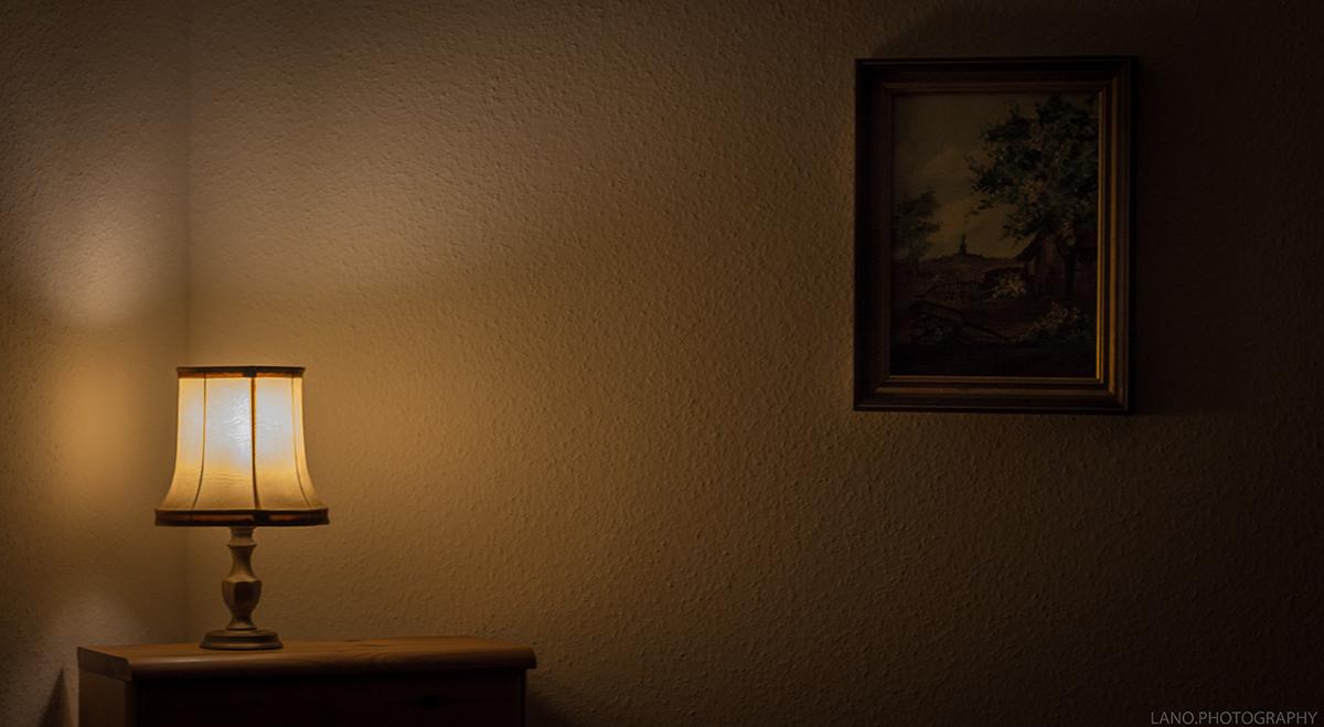 squarerooms Lalesh Aldarwish dim living room light dark yellow lamp side table art painting