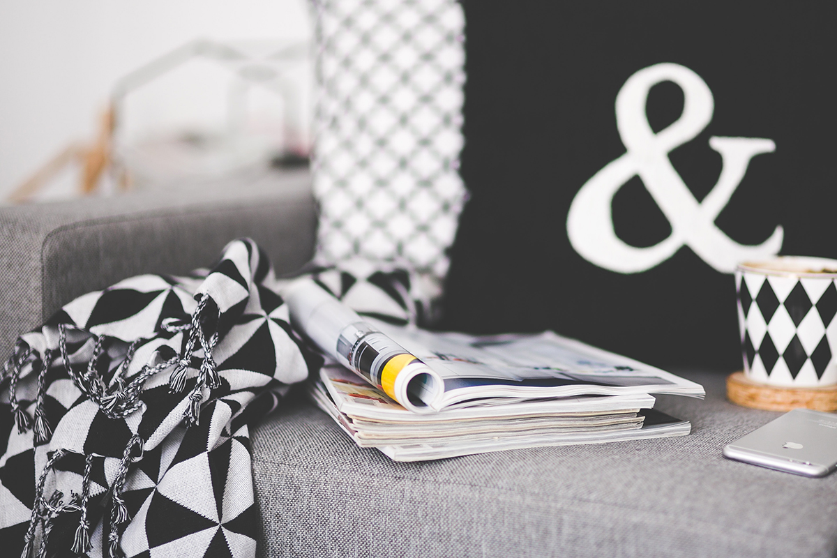 squarerooms sofa couch with magazine stack black and white cushions cosy aesthetic living room