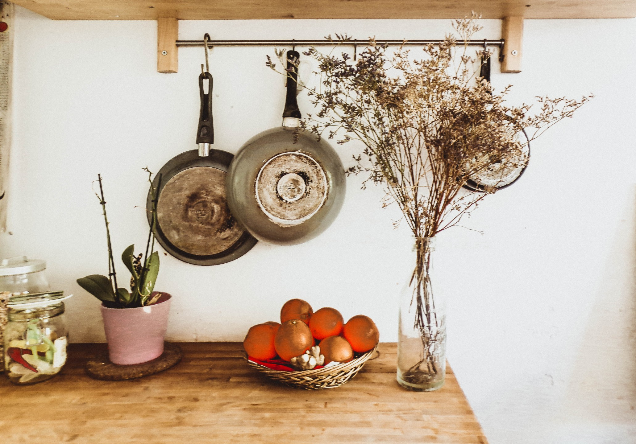 squarerooms niki nagy metal steel pans hanging kitchen wall wooden table rustic countryside farmhouse dried flowers