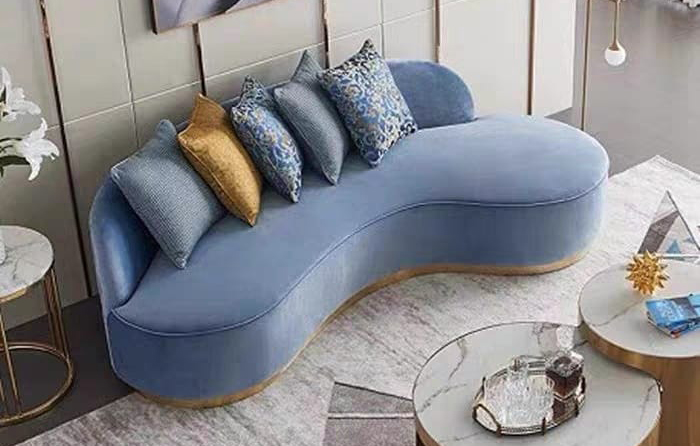 squarerooms blue couch sofa rounded curved living room yellow cushion