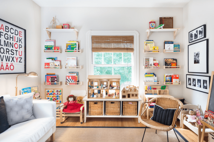 room showing a window with shelves filled with kids toys