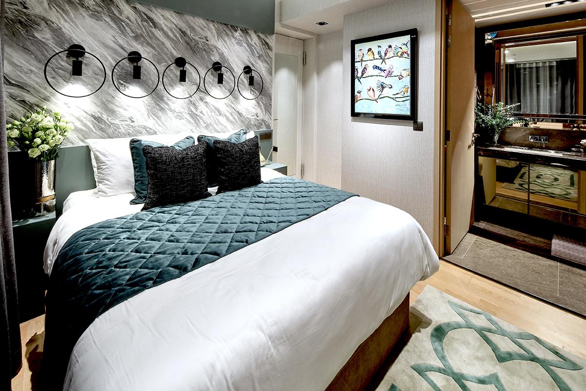 squarerooms spaceone interior design eclectic condominium unit monochromatic bold colourful artwork bedroom blue green