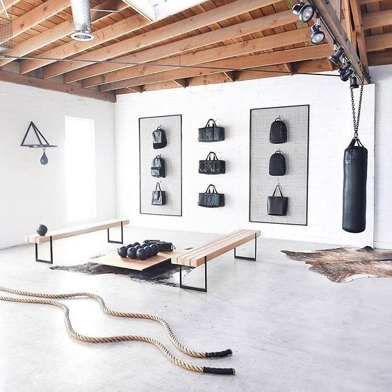 home gym with equipment and wall storage
