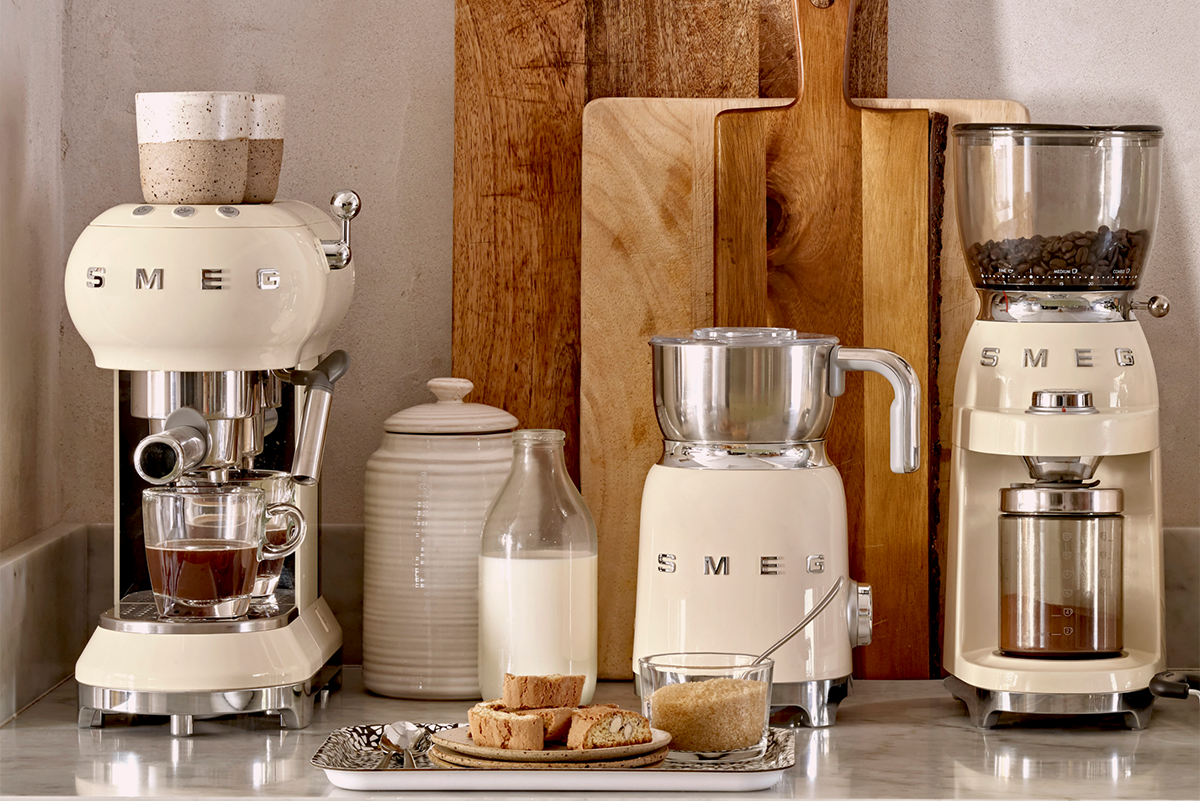 squarerooms smeg kitchen appliances lifestyle beige nude neutral colours wooden cutting boards coffe machine milk frother