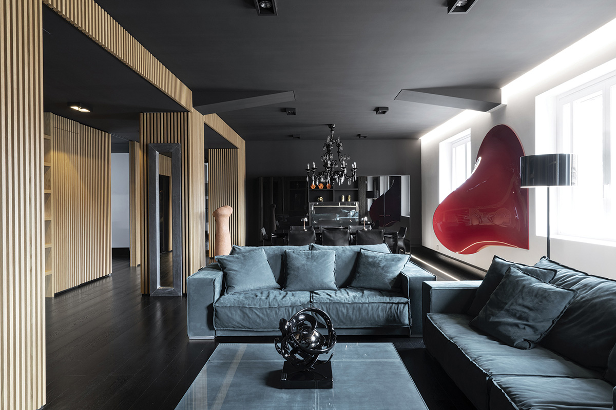 squarerooms damilano studio milan apartment monochromatic sleek minimalist modern living room blue couch red artwork
