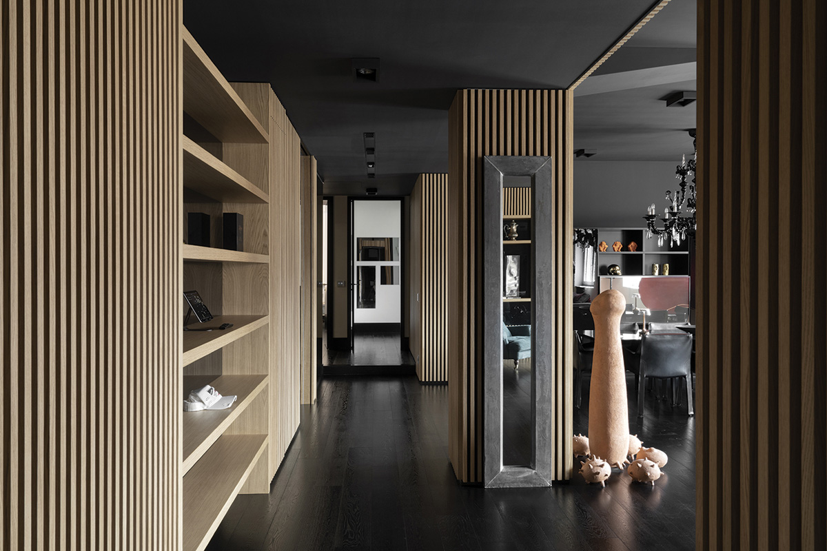 squarerooms damilano studio milan apartment monochromatic sleek minimalist modern overall view living area common wood shelves art