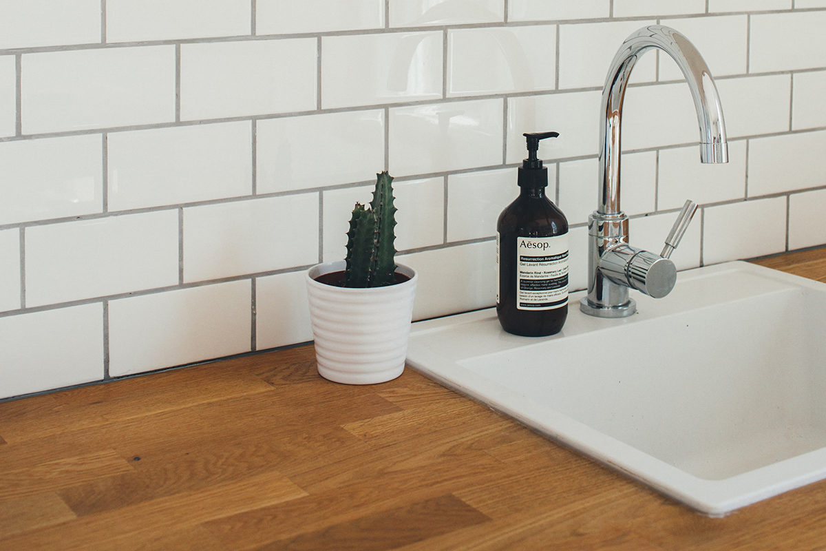 charles-deluvio squarerooms wooden countertop kitchen sink white tap faucet tiles backsplash