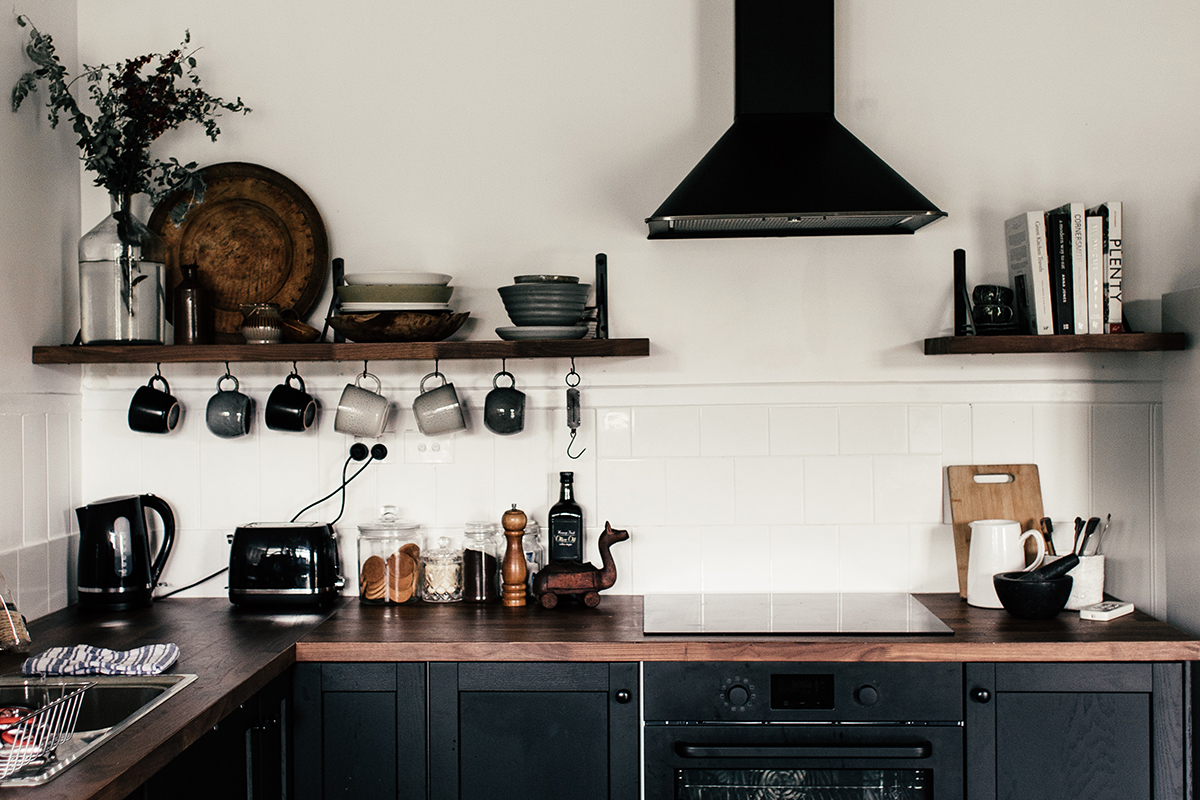 rachel-claire squarerooms dark black kitchen wooden countertop rustic industrial cooker hood