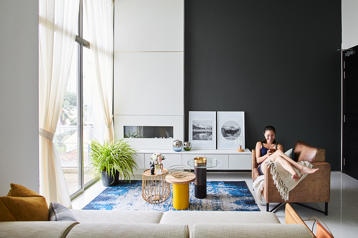 squarerooms bowerman interior planner home renovation design bold eclectic colourful penthouse apartment singapore flat living room big window light natural rug couch blue plants bright