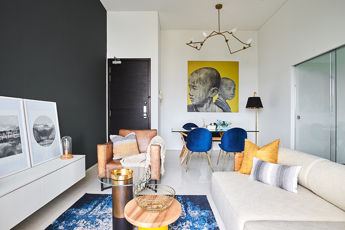 squarerooms bowerman interior planner home renovation design bold eclectic colourful penthouse apartment singapore flat living room bright rug couch blue orange bronze warm dining room