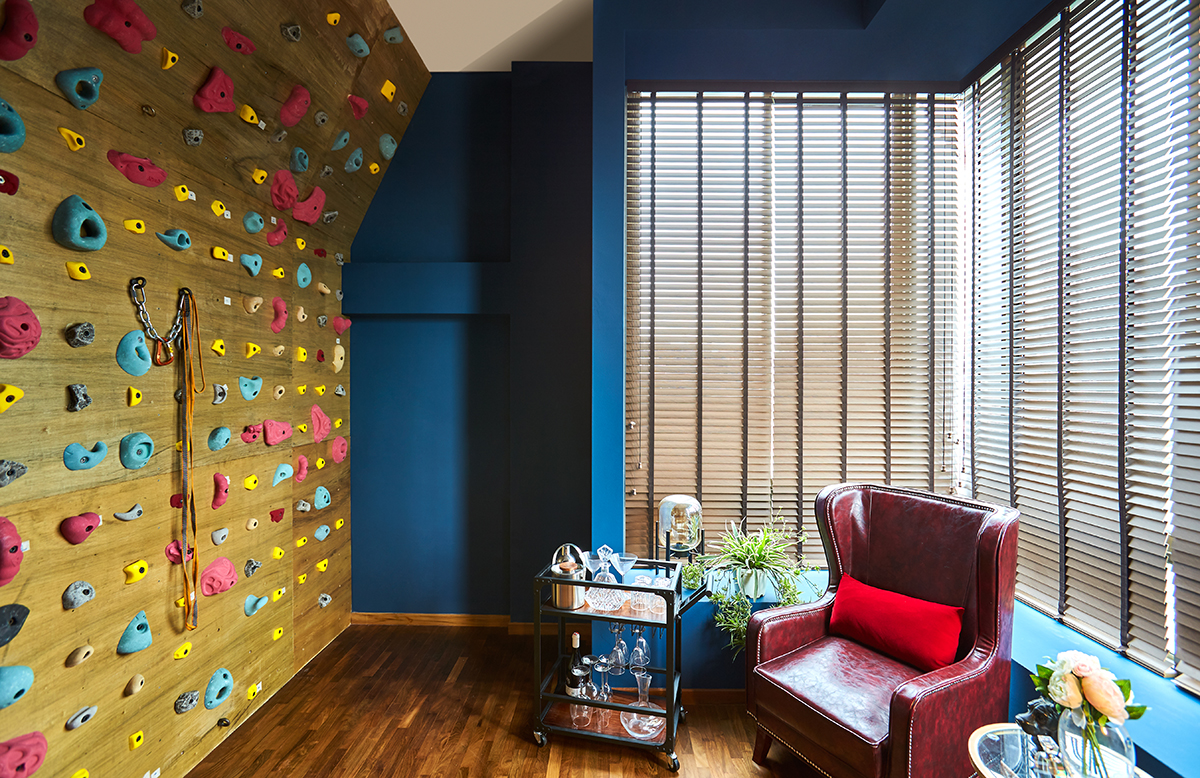 squarerooms bowerman interior planner home renovation design bold eclectic colourful penthouse apartment singapore flat climbing wall rock blue yellow red armchair
