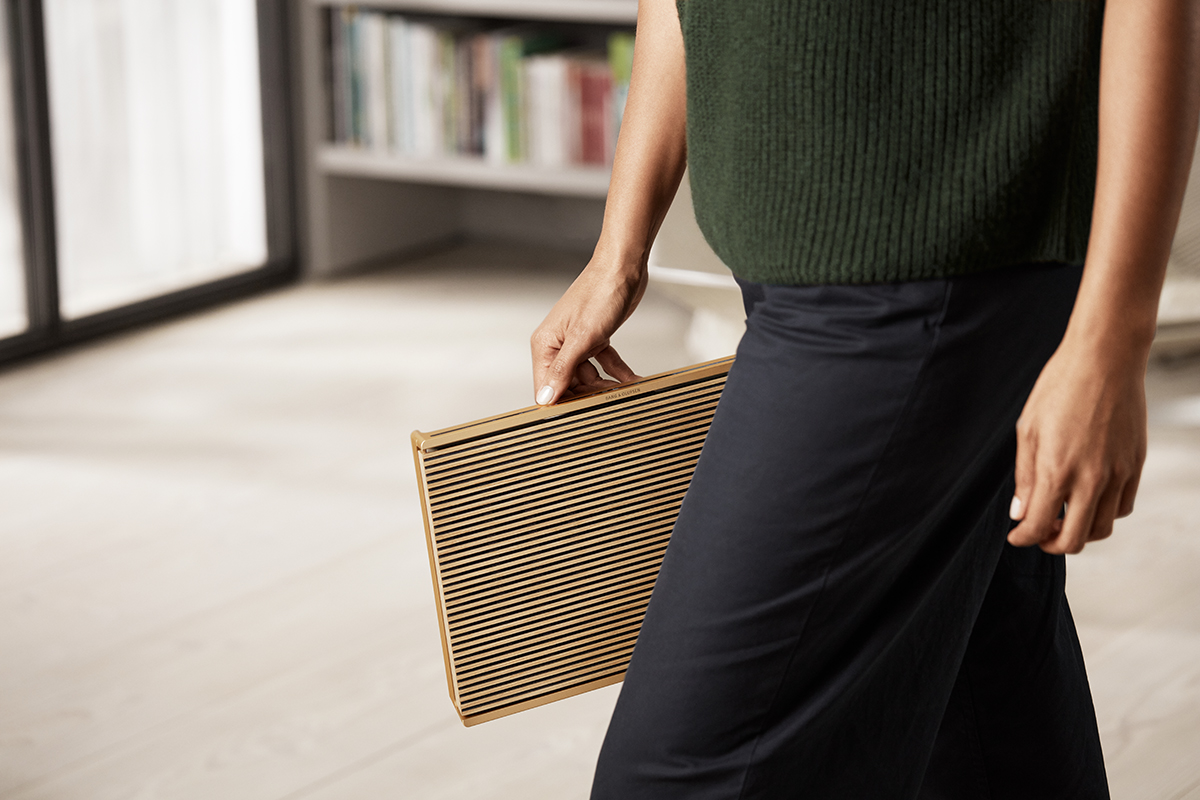 squarerooms bang and olufsen beosound level speaker audio sound new designer gold woman carrying holding walking
