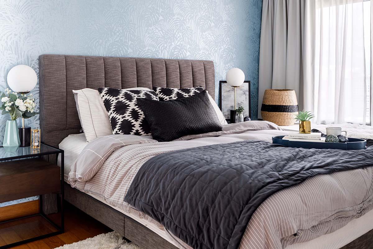 squarerooms home philosophy renovation 30K budget cost condo blue wallpaper wall bedroom bed