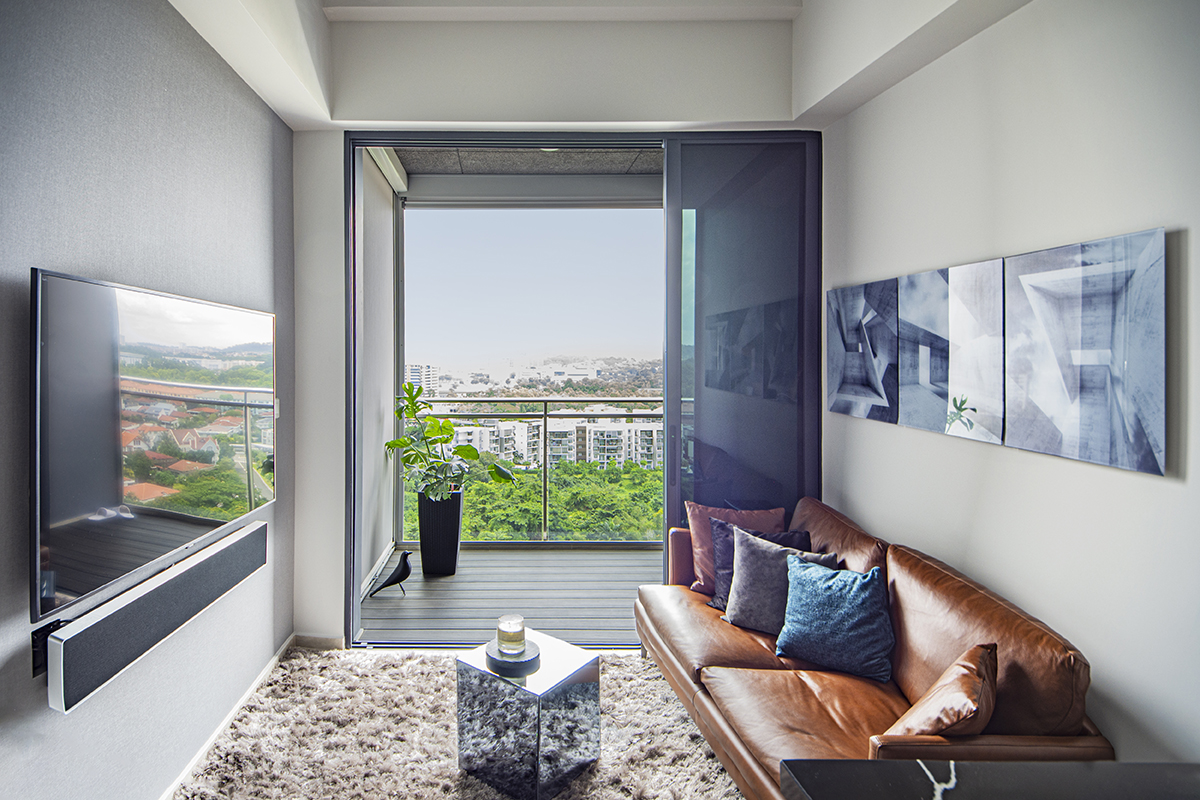 squarerooms distinctidentity home renovation interior design cost budget 20k living room couch window view balcony