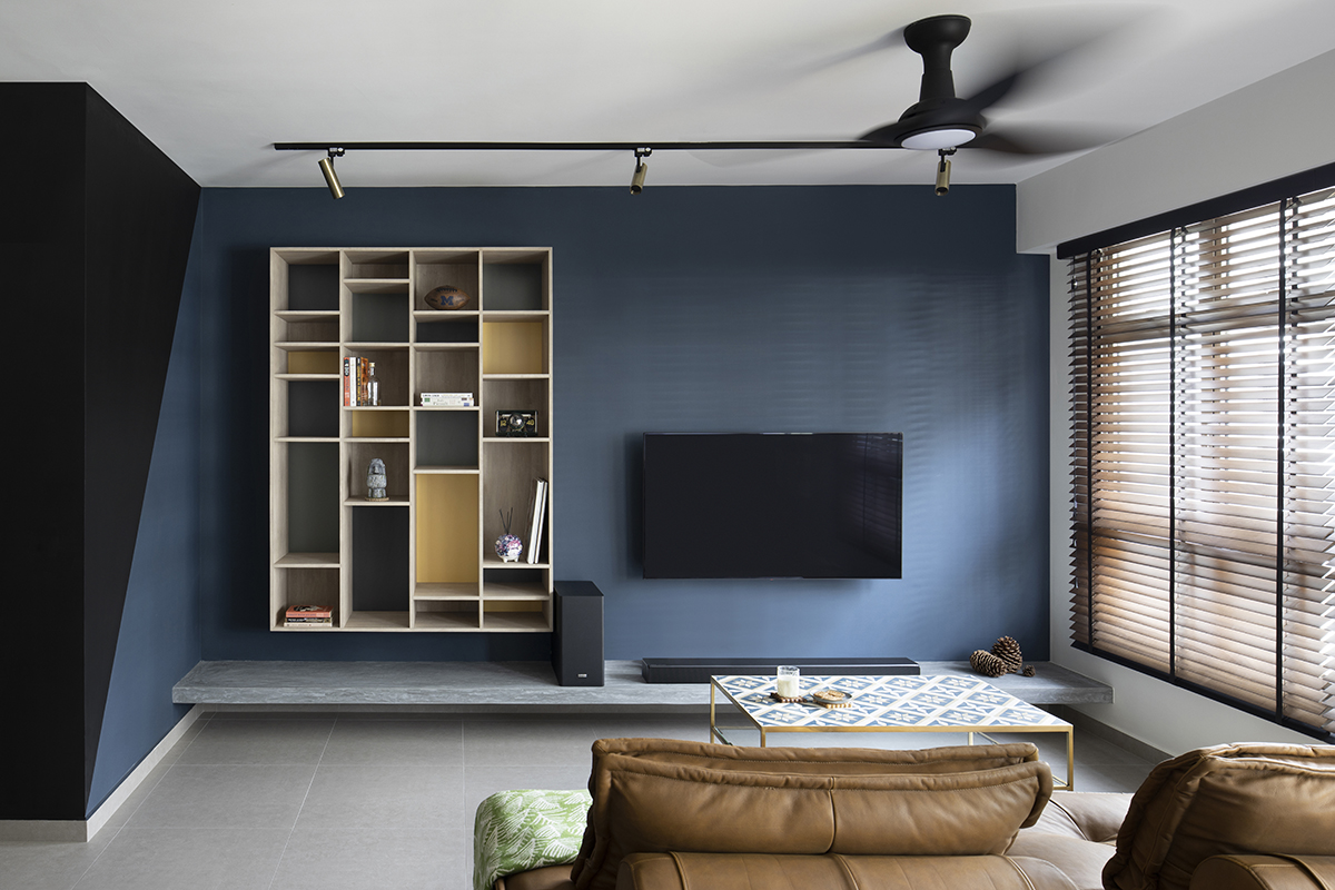 squarerooms versaform home bto hdb 5-room flat renovation interior design squarerooms versaform home bto hdb 5-room flat renovation interior design blue wall storage cabinet open shelves wood living room tv couch
