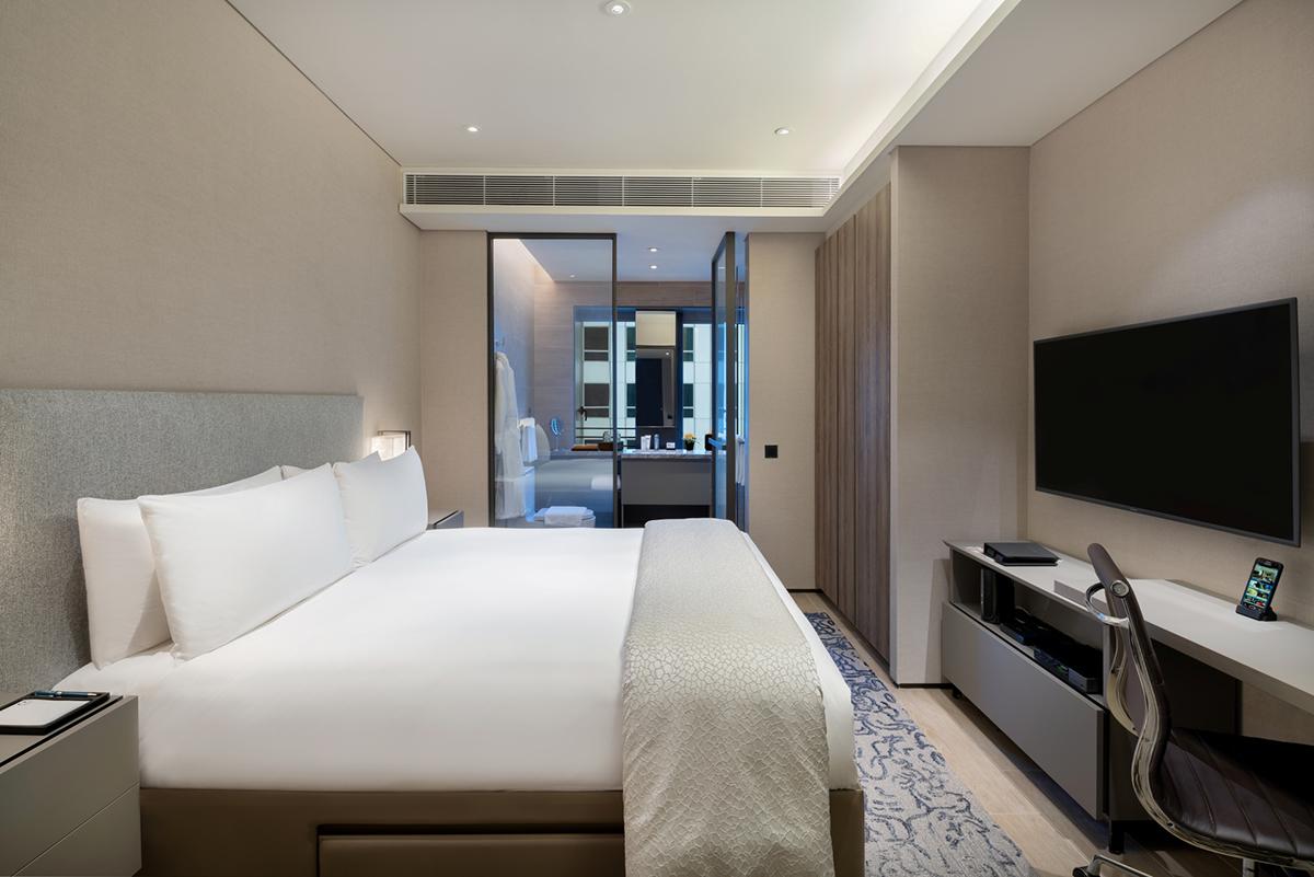 squarerooms oakwood retreat short term singapore bedroom deluxe white minimalist grey