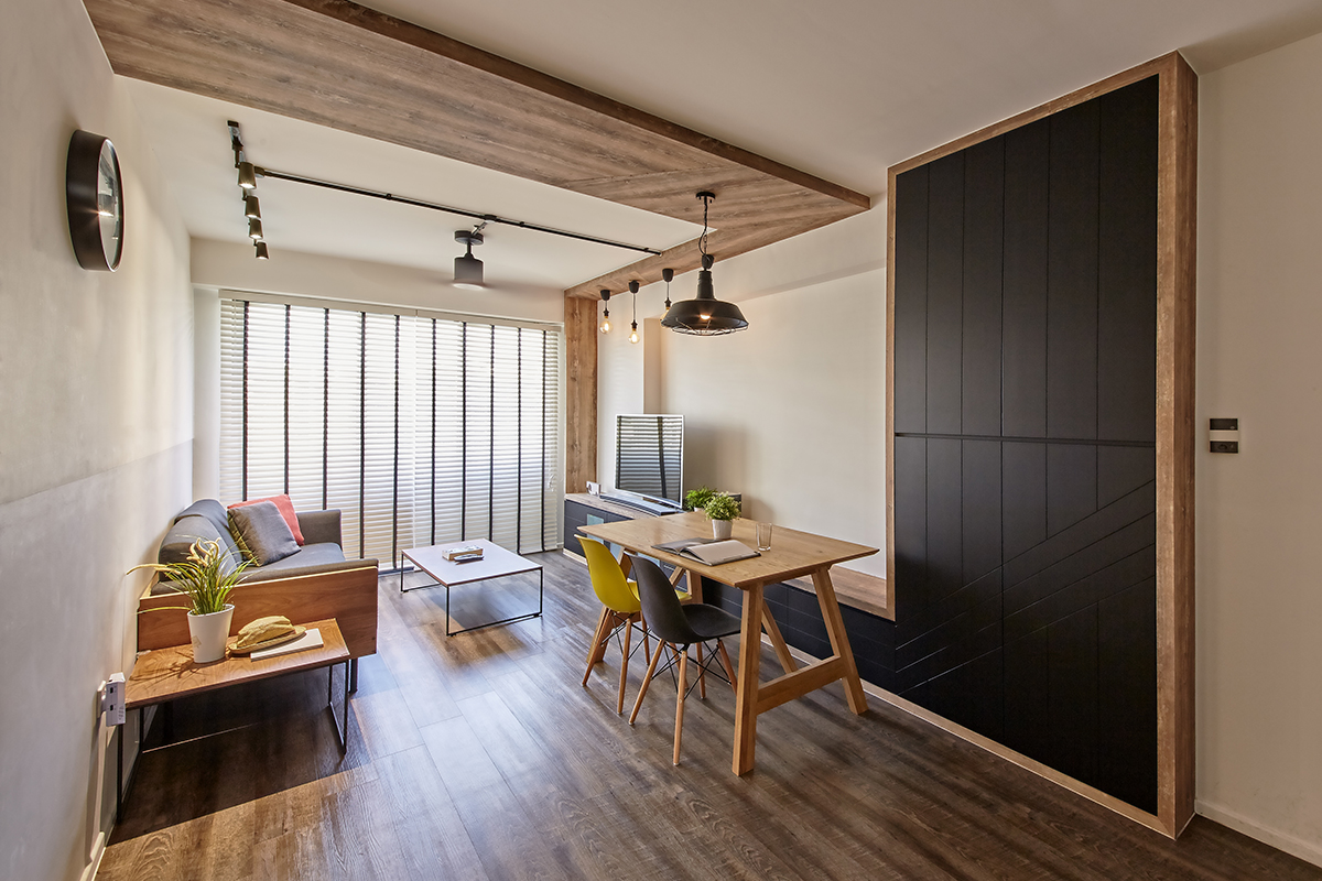squarerooms ju design studio home renovation 4 room hdb flat industrial cosy dark wood punggol living room area communal zone table couch floor