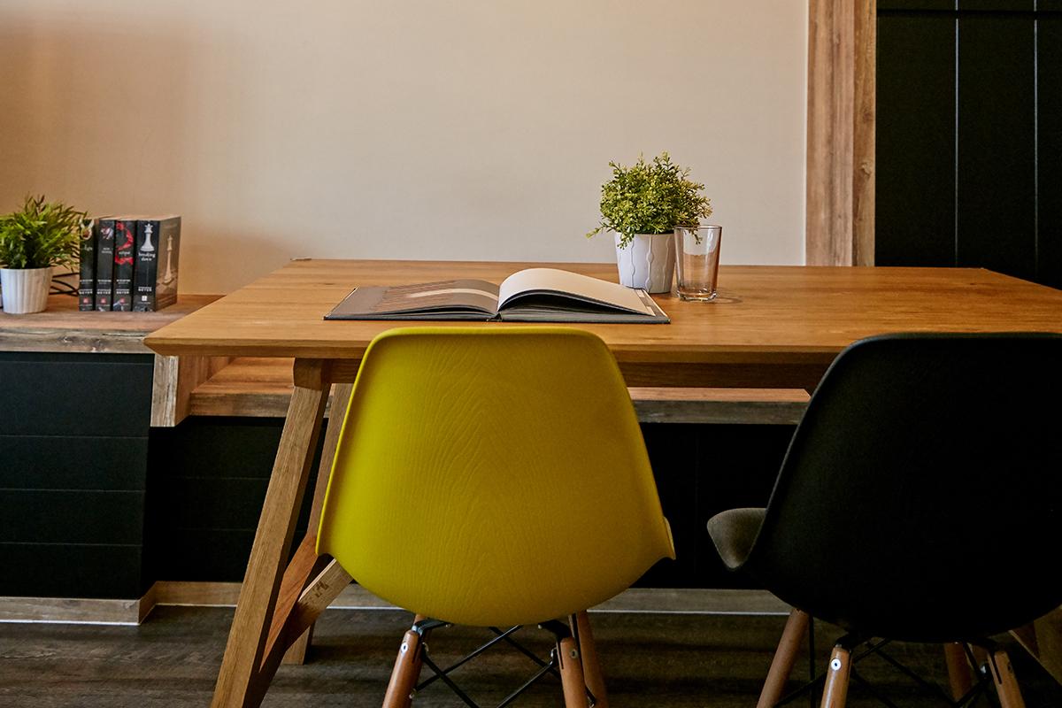 squarerooms ju design studio home renovation 4 room hdb flat industrial cosy dark wood punggol dining nook table yellow chair