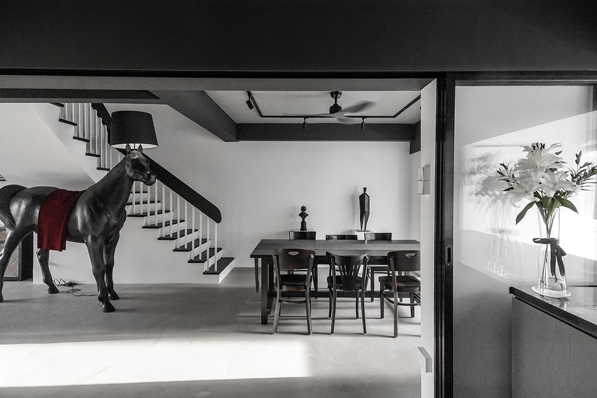 squarerooms versify studio architecture interior design home inspo house tour landed property monochromatic black and white modern designer horse lamp dining room area table stairs staircase front moooi