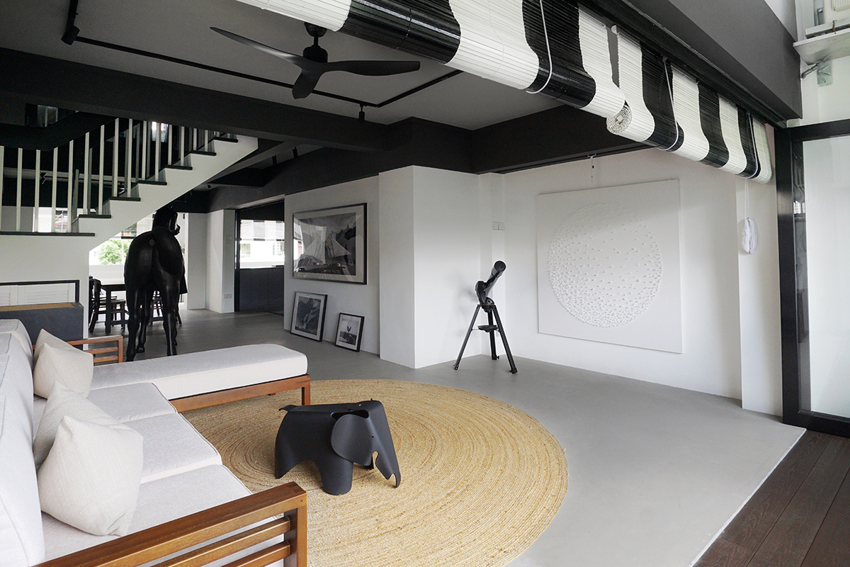 squarerooms versify studio architecture interior design home inspo house tour landed property monochromatic black and white modern living room cream rug couch open