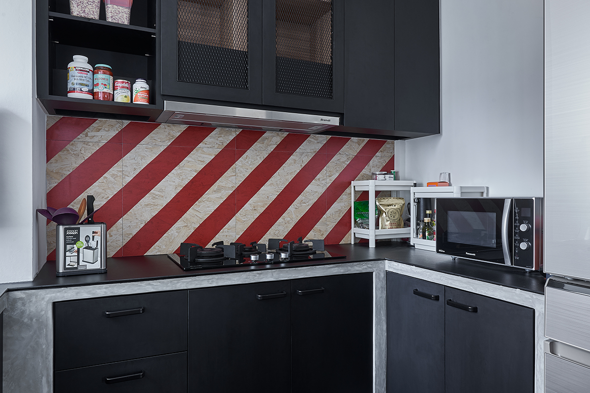 squarerooms ju design studio home budget renovation dark black grey monochromatic industrial kitchen red backsplash