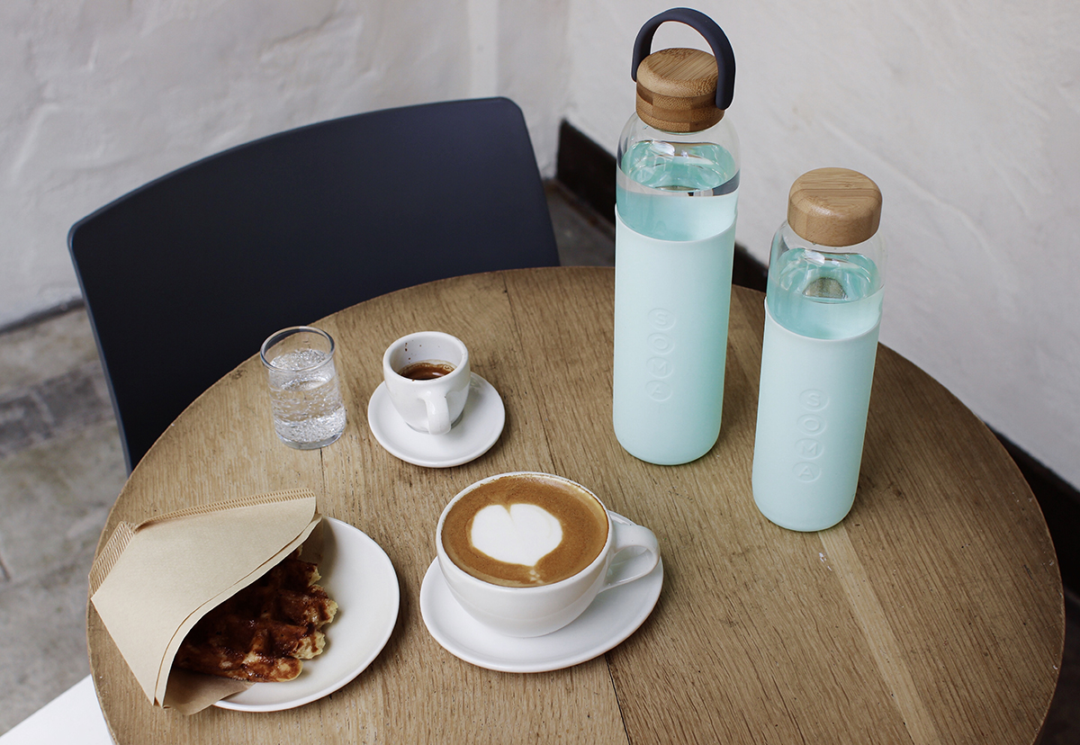 squarerooms soma bottles glass reusable sustainable eco friendly mint blue green wood table chair coffee