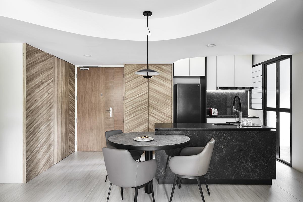 squarerooms notion of w home renovation hdb bto flat minimalist luxury monochromatic black and white wood kitchen dining island lamp