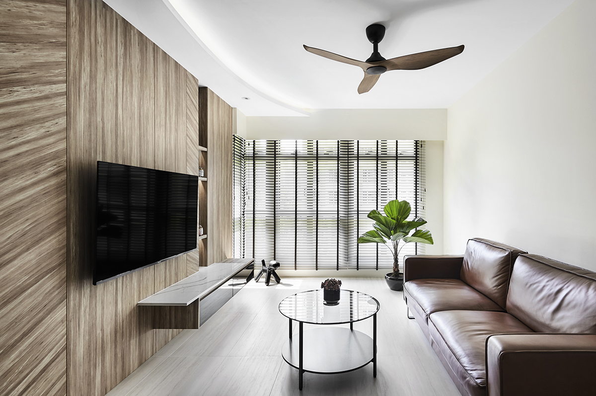 squarerooms notion of w home renovation hdb bto flat minimalist luxury monochromatic black and white wood couch sofa leather feature wall living room