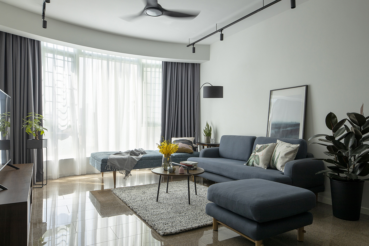 squarerooms d'marvel scale condominium home renovation modern eclectic interior design living room area blue couch minimalist simple