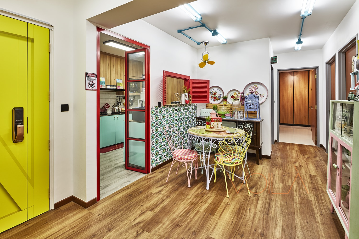 squarerooms Voila maximalist colourful bold home red yellow wood floors door frame table vintage