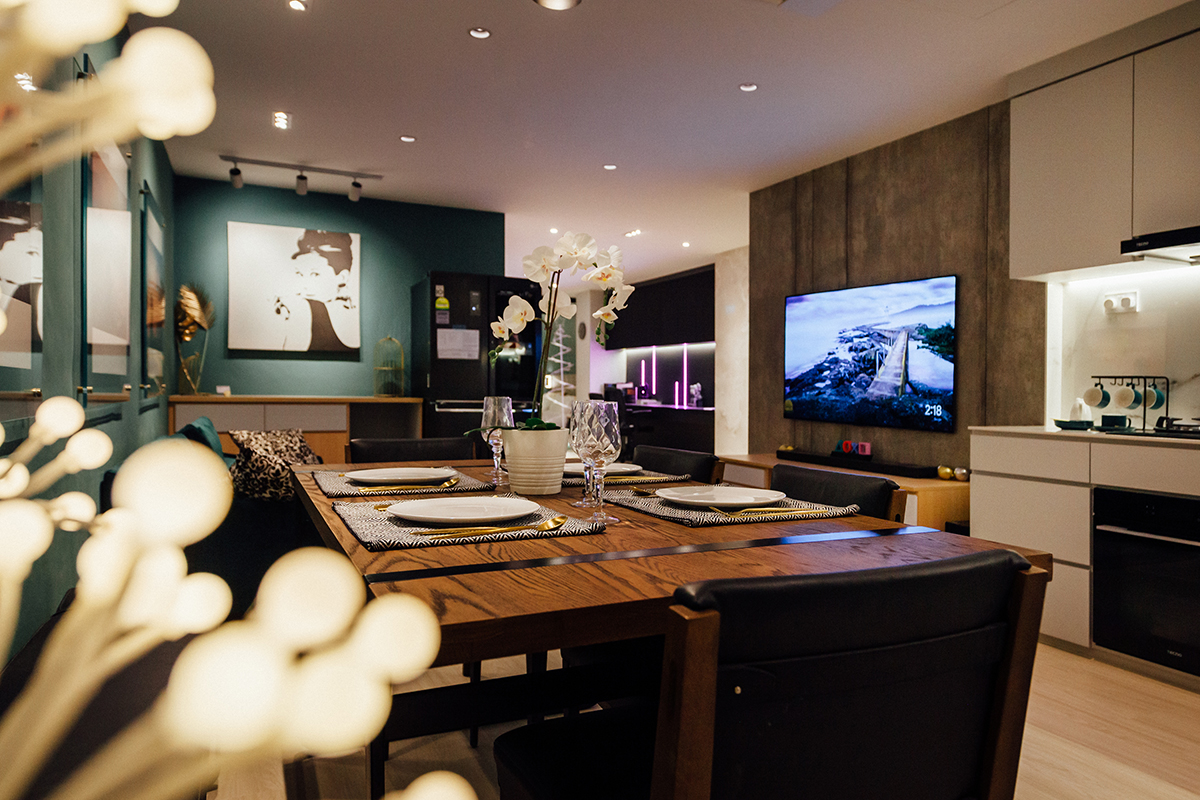 squarerooms darwin interior studio apartment smart living home design interior renovation contemporary modern dining living room wood table emerald green wall white kitchen grey feature