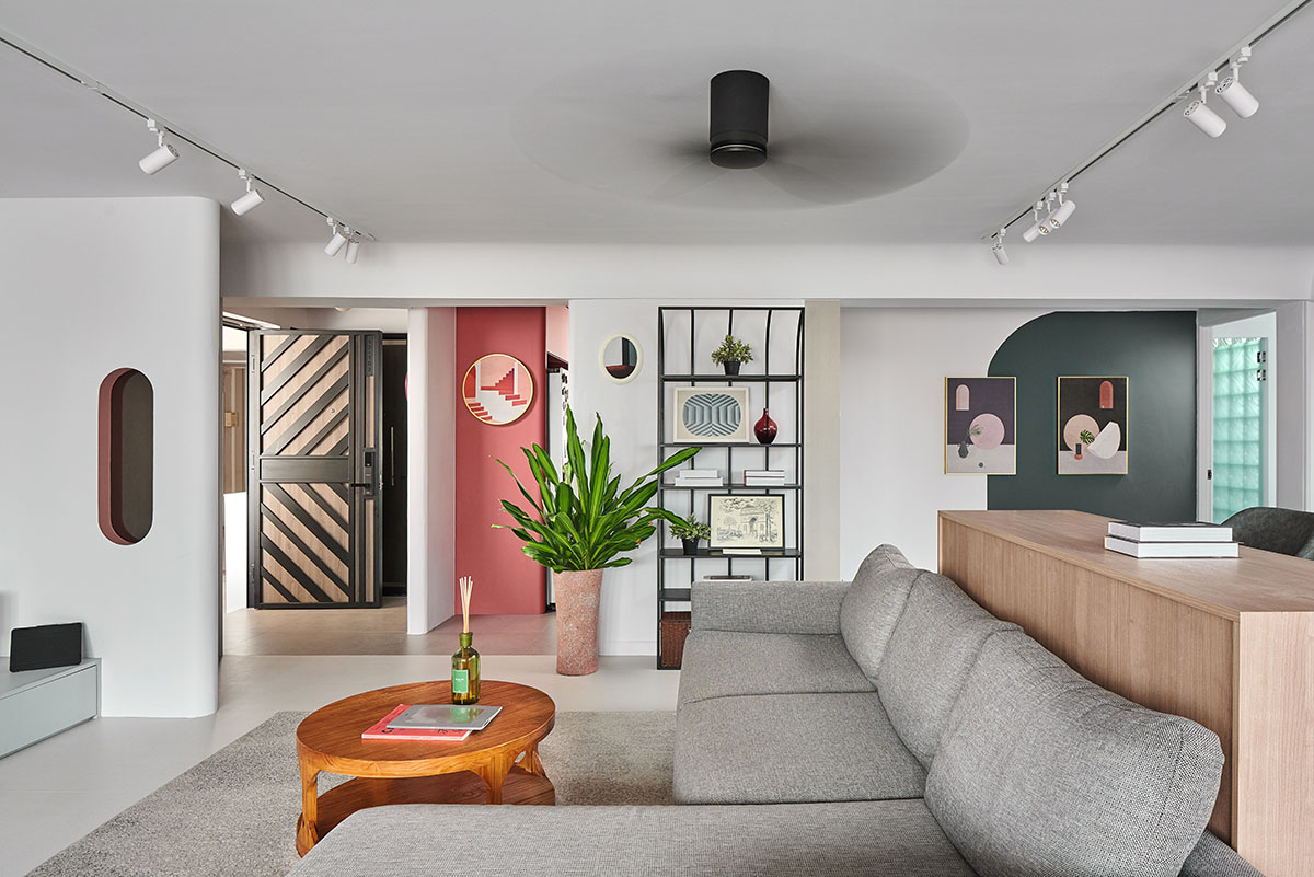squarerooms eightytwo home renovation 3 room hdb resale flat interior design makeover contemporary style joo seng living room grey couch pink feature wall