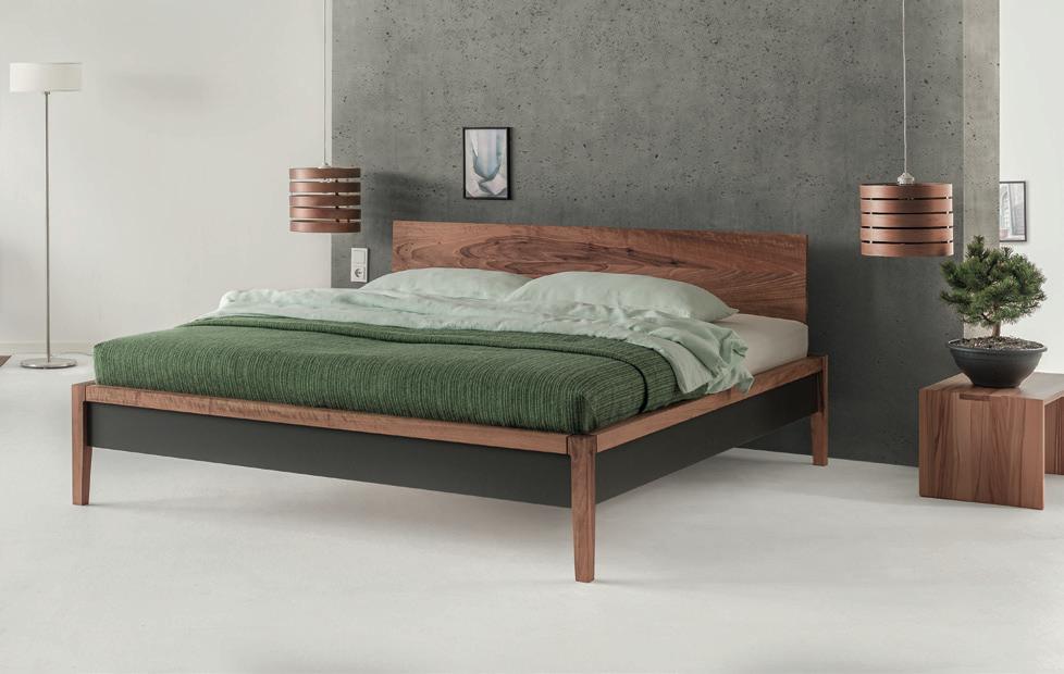 squarerooms dormiente solid wood bed frame base green sheets blanket duvet pillows bedroom