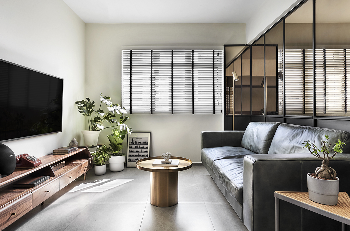 squarerooms happe design atelier hda studio home renovation makeover 3 room resale hdb flat contemporary living room grey bronze tinted glass divider coffee table