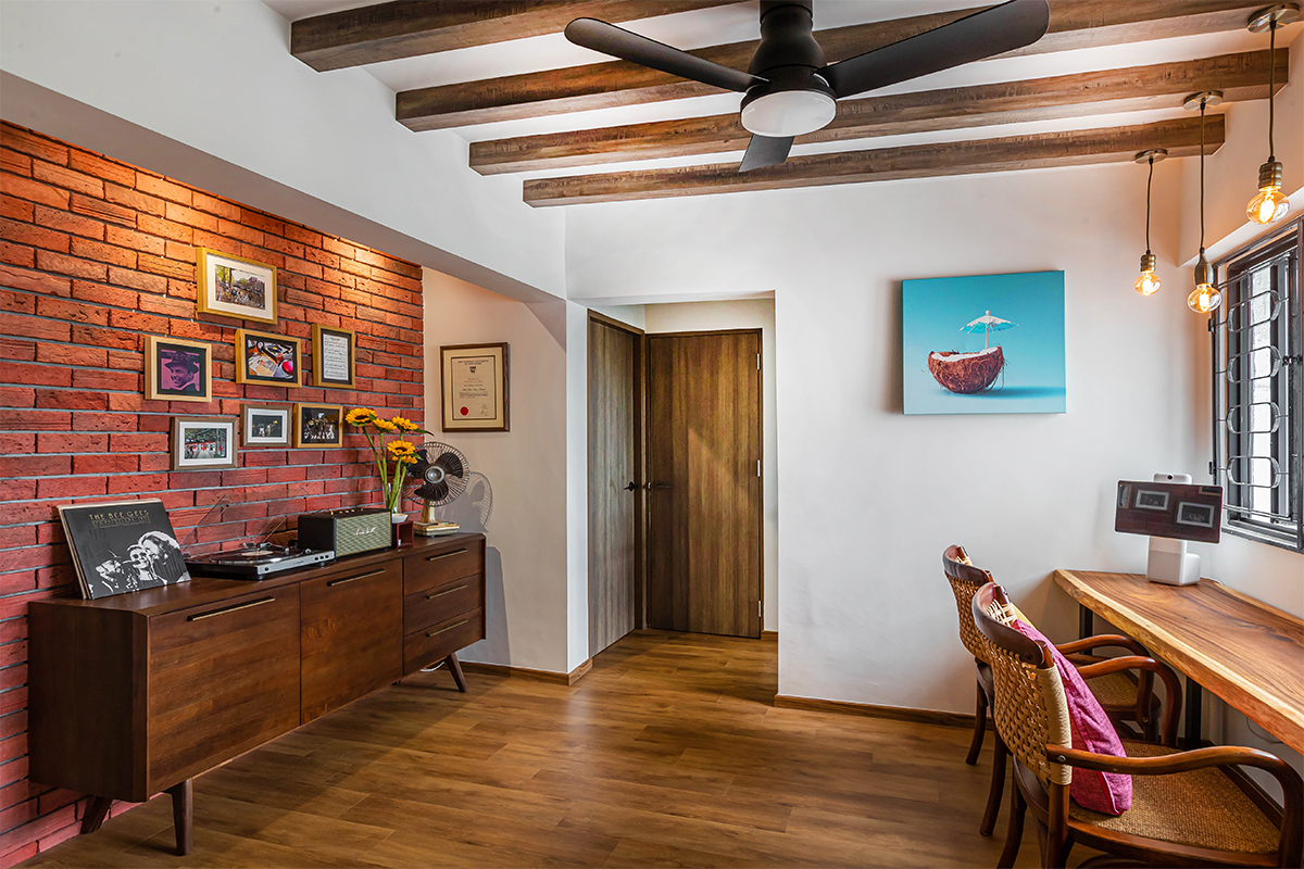 squarerooms renozone home renovation interior design makeover 4 room hdb bto flat eclectic retro vintage style jurong west living room brick wall sideboard wood desk table beams ceiling