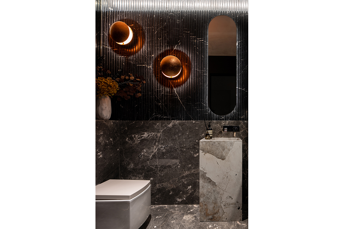 squarerooms abcd a blue cube design showroom modern luxury luxe dark marble commercial space bathroom washroom toilet sink dekton cosentino eclipse lights rose gold fluted black grey walls