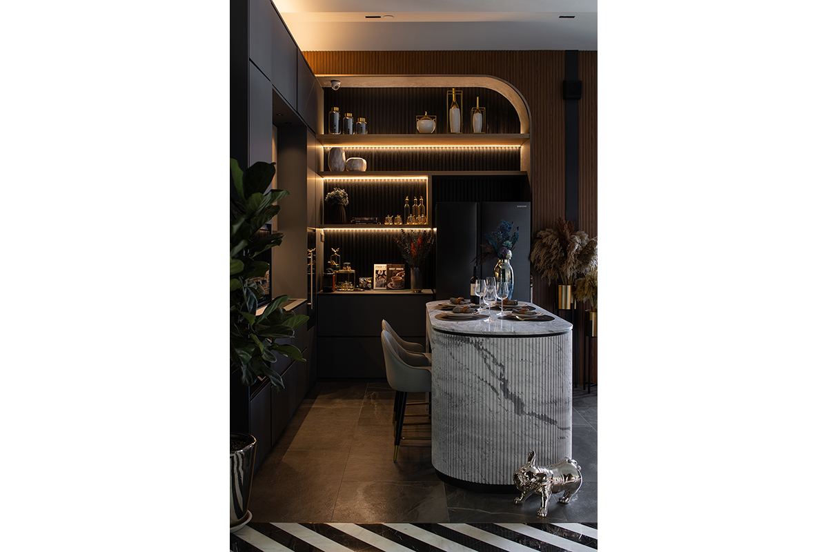 squarerooms abcd a blue cube design showroom modern luxury luxe dark marble commercial space kitchen island white grey veined mood lighting shelf