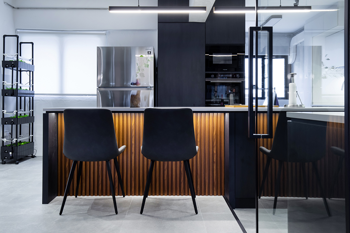 squarerooms inizio atelier interior design home renovation makeover hdb 5 room resale flat industrial contemporary monochromatic sleek kitchen island counter orange fluted panelling