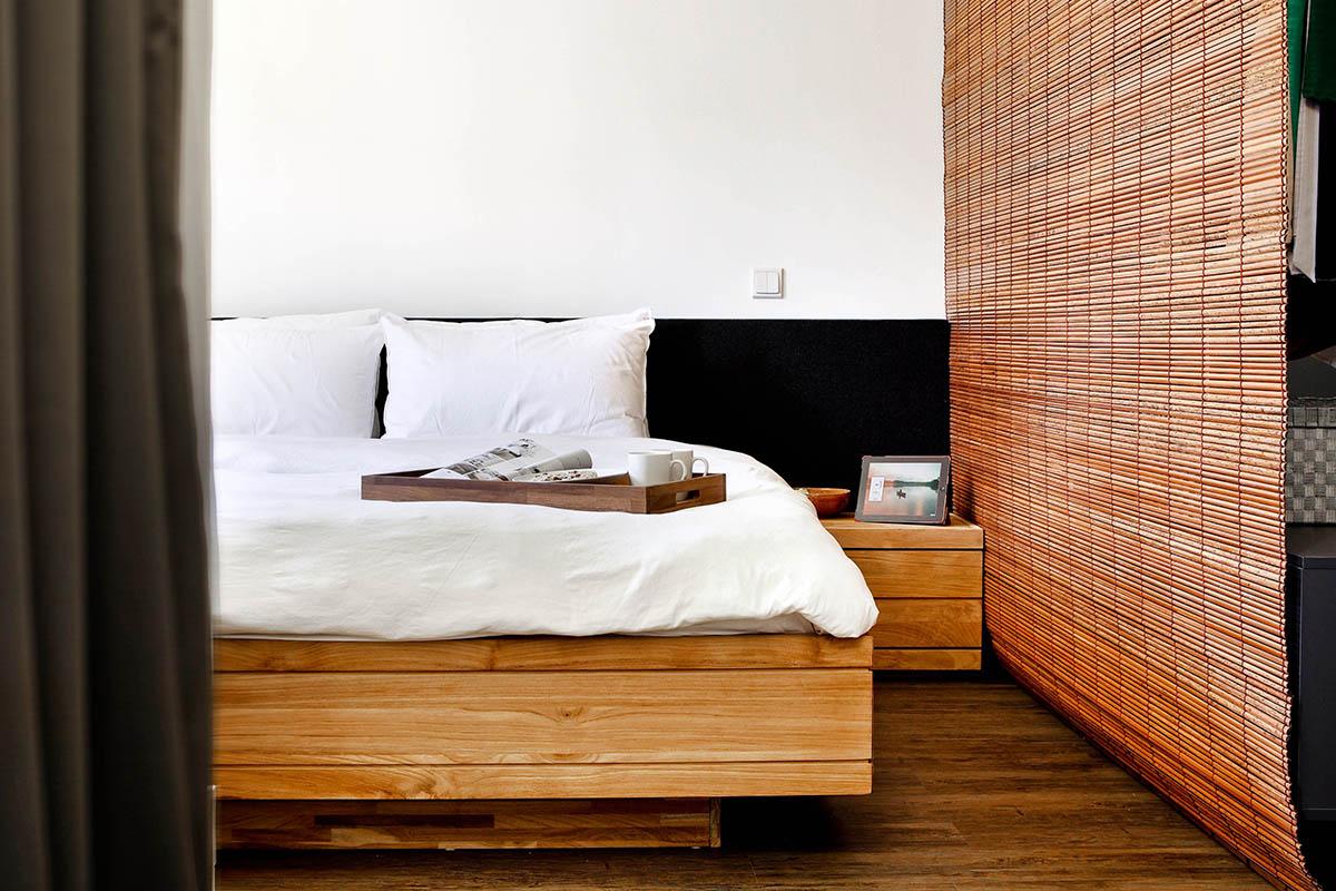 squarerooms The Design Abode bedroom wood platform bed thick base slats rustic japanese japandi bamboo shutters room divider curtain white