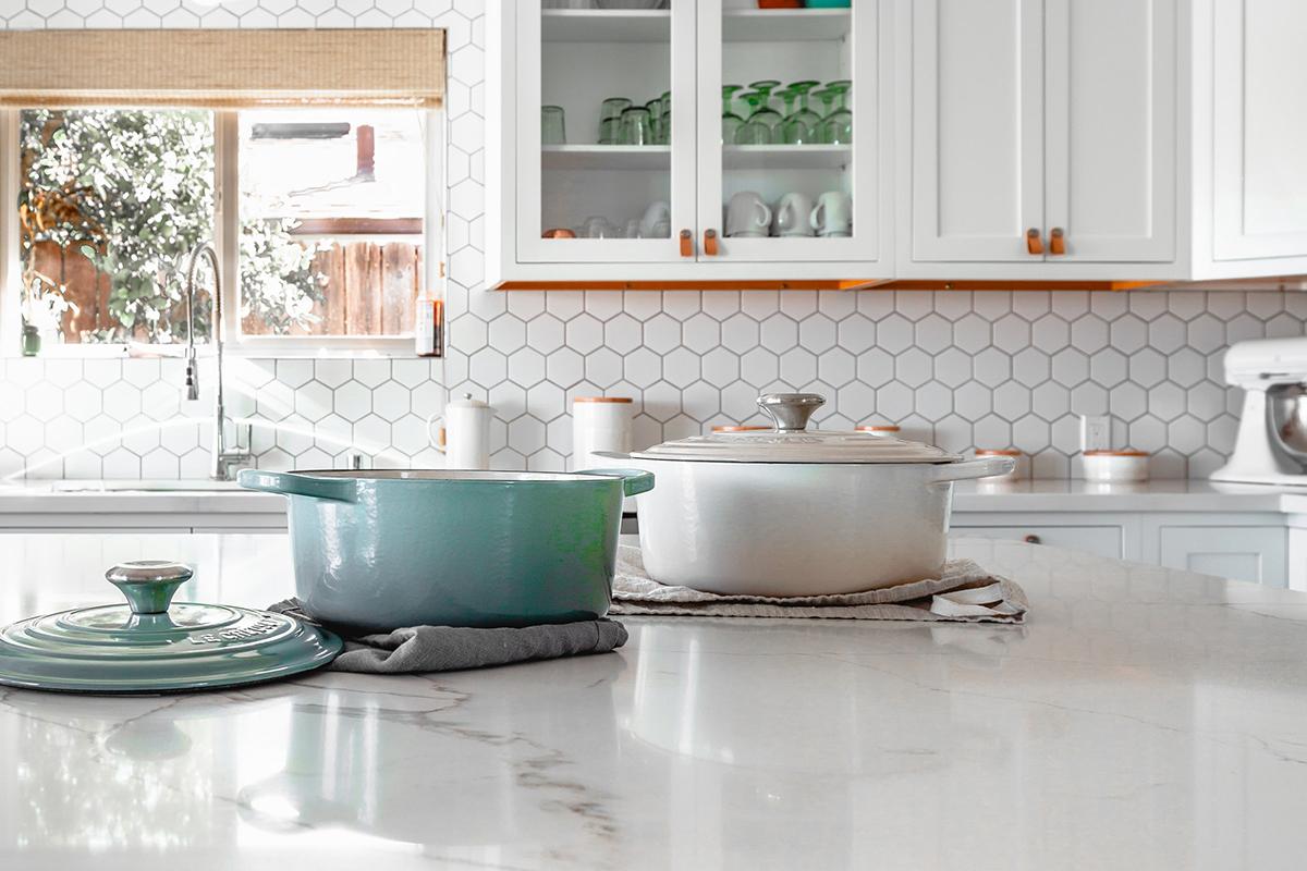 squarerooms Roam in Color Unsplash kitchen cookware cooking appliances pots pans white farmhouse style countertop pastel blue