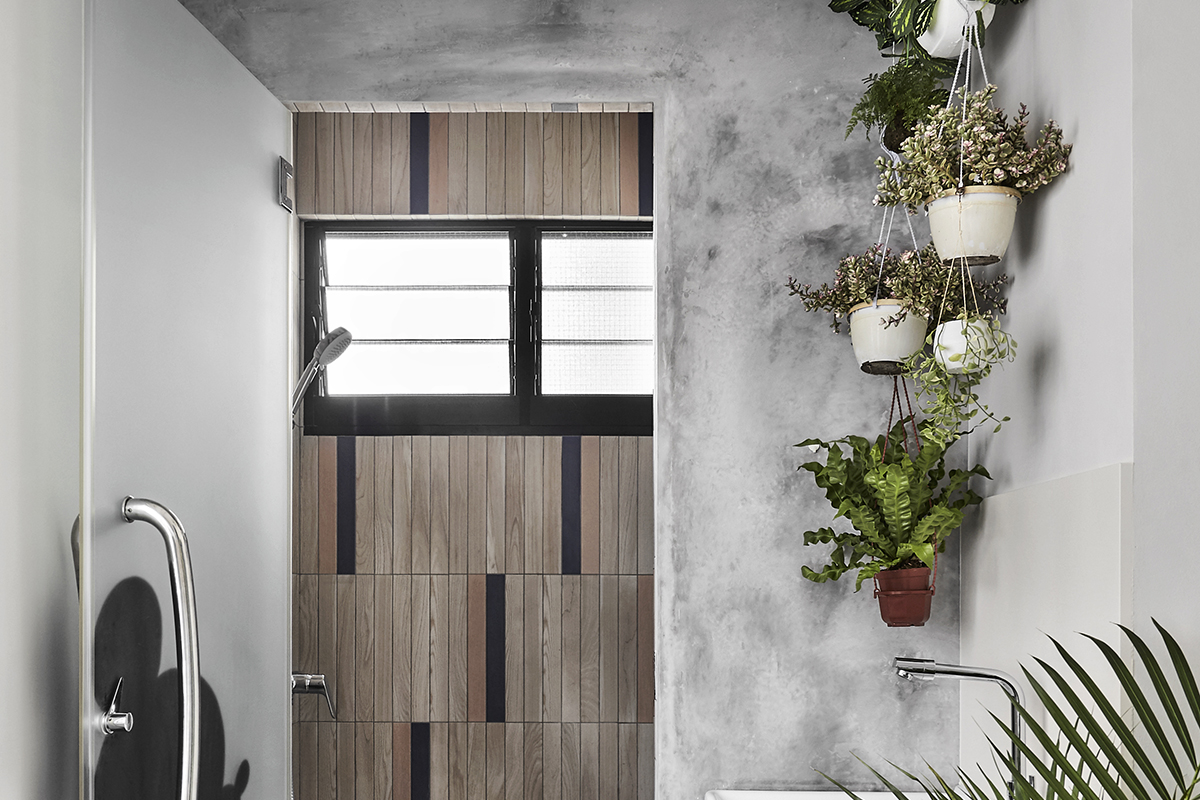 squarerooms Notion of W minimalist modern grey bathroom wood tiles mickey mouse home plants air hanging