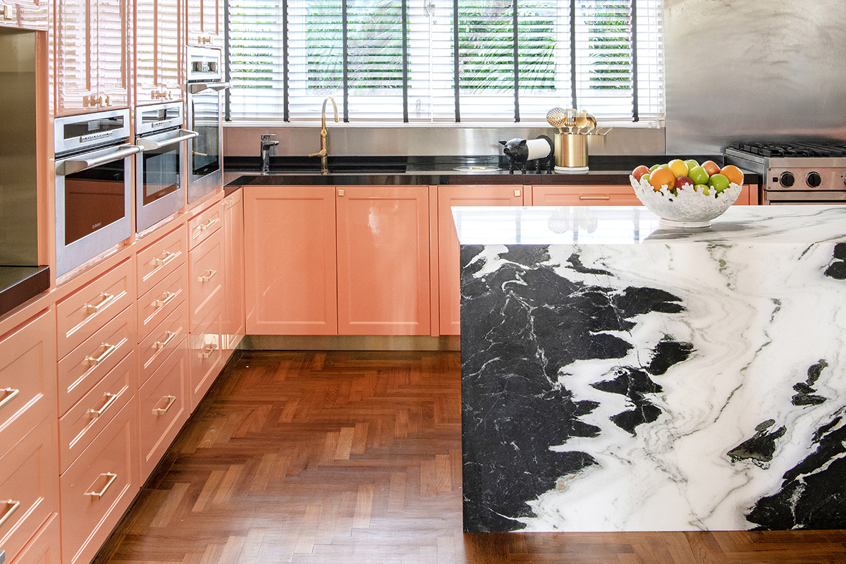 squarerooms maximalism maximalist home design look inspo inspiration interior ideas style decor pink salmon orange cabinets glossy kitchen cow pattern island marble