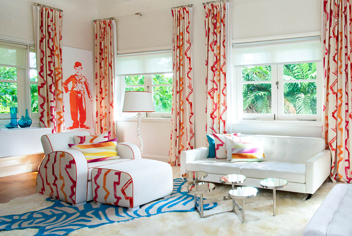 squarerooms maximalism maximalist home design look inspo inspiration interior ideas style decor red pink yellow design intervention living room curtains grand opulent quirky colourful couch sofa blue rug
