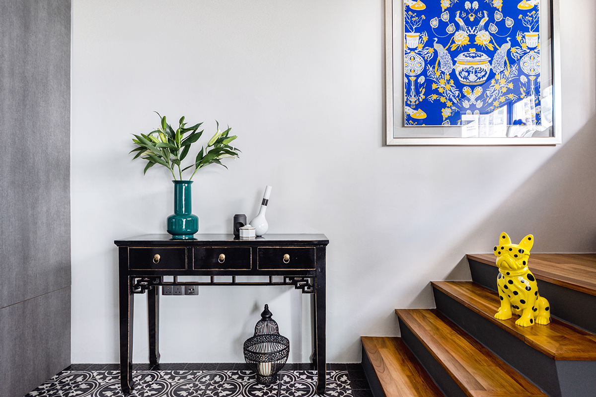squarerooms maximalism maximalist home design look inspo inspiration interior ideas style decor distinctidentity staircase wooden blue yellow pattern artwork sculpture black side table tiles