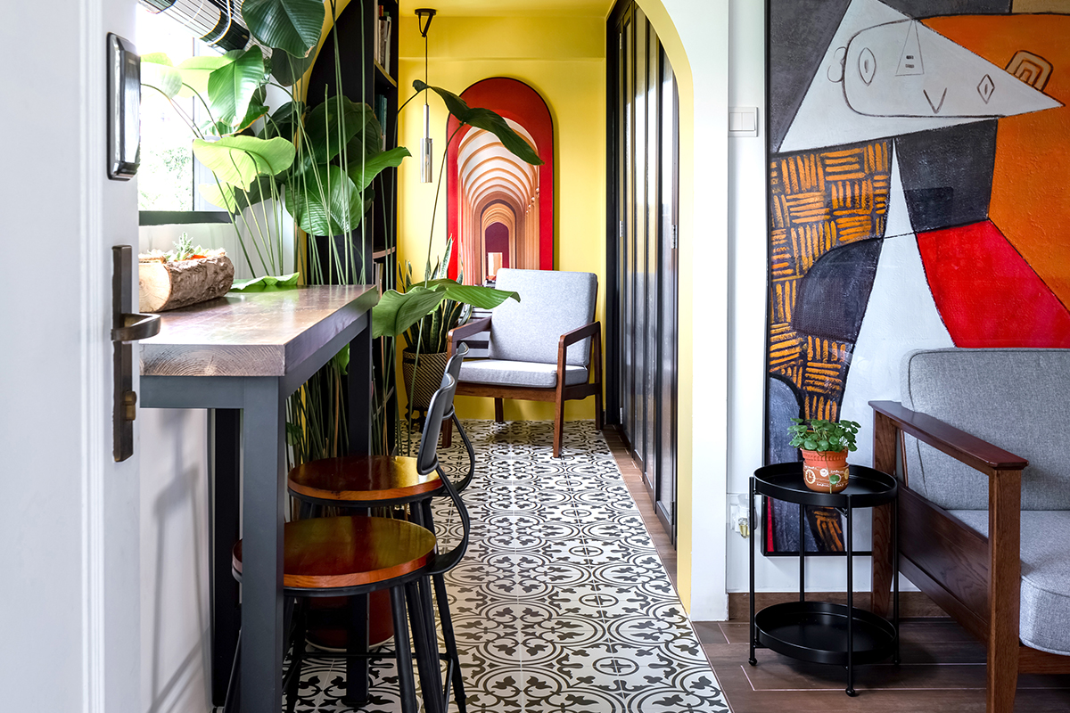 squarerooms maximalism maximalist home design look inspo inspiration interior ideas style decor insight out patterned bold colourful hallway corridor artwork mural yellow red blue pattern tiles floor